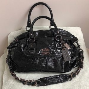 Patent leather coach bag.